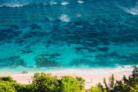 Tropical beach in Bali with transparent blue ocean