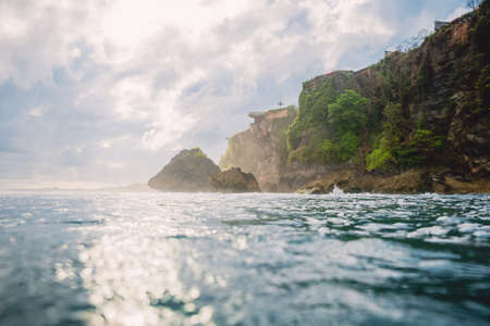 Ocean and cliff in Uluwatu with sunshine light. Bali, Indonesia