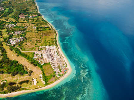Tropical island with resort, beach and turquoise ocean, aerial view. Gili islands Stock Photo