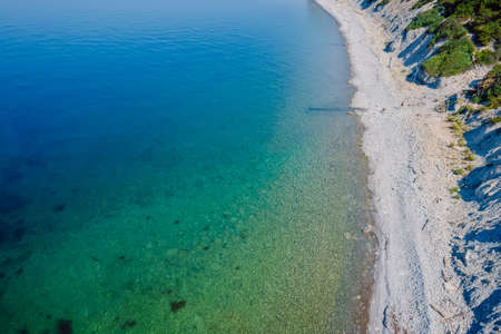 Aerial view of coastline with quiet sea and beach. Summer day on sea Foto de archivo