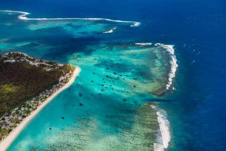 Tropical coastline in Mauritius and ocean. Aerial view of One eye beach