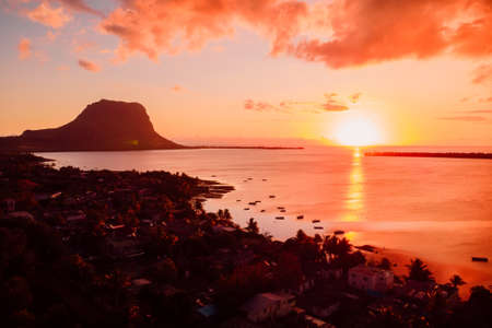 Aerial view at sunset with Le Morn mountain in Mauritius.