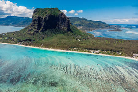 Tropical island with Le Morne mountain, blue ocean and coastline in Mauritius. Aerial view