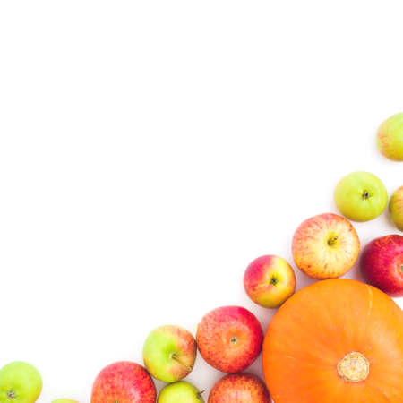 Food frame with apple fruits and pumpkin on white background. Flat lay, top view Foto de archivo