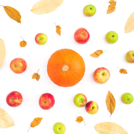 Autumn background with fall leaves, apple and pumpkin on white background. Flat lay, top view