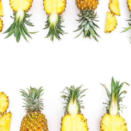 Juicy pineapple fruits on white. Flat lay, top view. Food concept. Foto de archivo