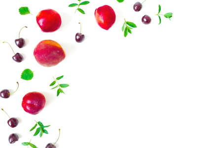 Peaches with sweet cherry and mint on white background. Top view. Flat lay