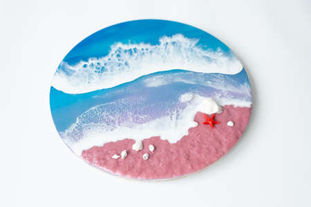 Resin art with sea waves and beach with starfish. Epoxy paint art