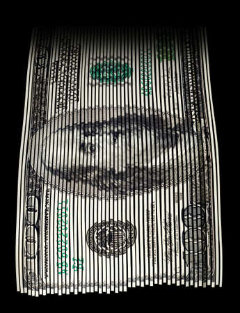 Shredded US hundred dollar bill on black background. Concept for money wasting, money value and savings. photo