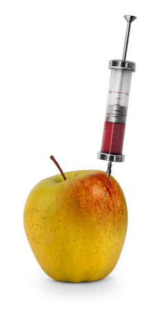 surgical needle: Red liquid being injected into apple. Concept for genetically modified foods.