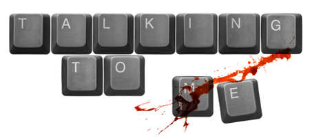 bothered: Keys, from classic computer keyboard, spelling Talking To Me. A red liquid, similar to blood, splashed over the keys to emphasize Concept of Conflict and Aggression. Stock Photo