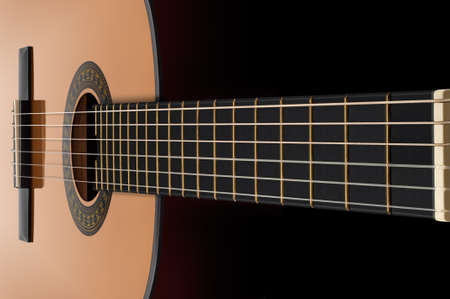 Particolare della chitarra classica su sfondo nero. Utilizzando focus stacking per prolungare profondità di campo.
