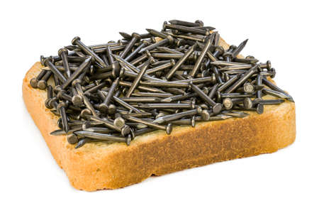 Nails on a slice of bread as a symbol of iron deficiency. Reklamní fotografie