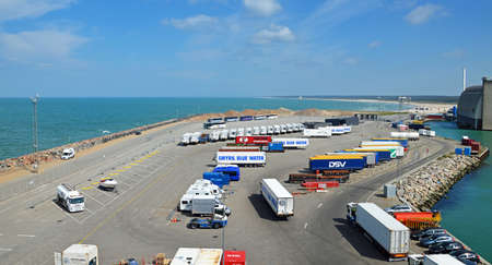 Hirtshals, Denmark - May 31, 2014: Trucks and buses waiting in the parking lot of the ferry terminal on the loading Onto a ferry to Iceland and the Faroe Islands. Hirtshals is an important ferry port in the north of Denmark. Editorial