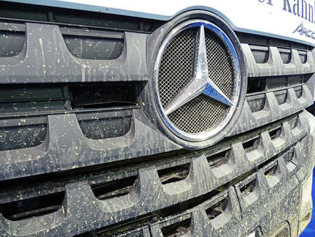 front end: Chemnitz, Germany - October 4, 2015: Muddy front end of a truck of the type Mercedes-Benz Arocs with the typical Mercedes star. Mercedes-Benz is a trademark of vehicles of Daimler AG. Editorial