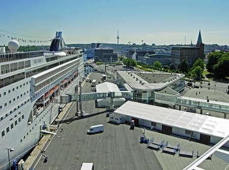 kiel fjord: Kiel, Germany - May 30, 2009: The cruise ship MSC Opera from MSC Cruises has moored at the cruise terminal Ostseekai in Kiel. Kiel is an important embarkation port for cruises on the Baltic Sea and towards Norway.