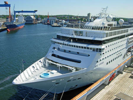 Kiel, Germany - May 30, 2009: The cruise ship MSC Opera from MSC Cruises has moored at the cruise terminal Ostseekai in Kiel. Kiel is an important embarkation port for cruises on the Baltic Sea and towards Norway.
