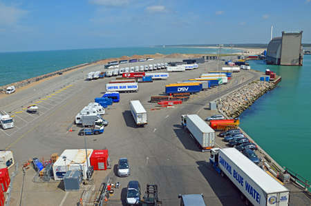 hirtshals: Hirtshals, Denmark - May 31, 2014: Trucks and buses waiting in the parking lot of the ferry terminal on the loading Onto a ferry to Iceland and the Faroe Islands. Hirtshals is an important ferry port in the north of Denmark. Editorial