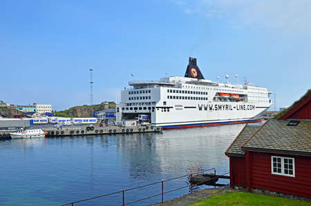 onward: Torshavn, Faroe Islands - June 5, 2014: The ferry ship Norrna from Smyril Line has moored at the ferry terminal in Torshavn. The ship arrived in the morning from Iceland and which prepared for the onward journey to Hirtshals Denmark. The Norrna ferry is a