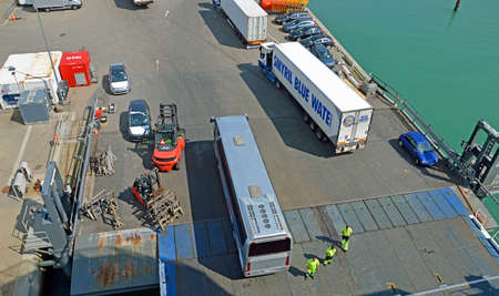 hirtshals: Hirtshals, Denmark - May 31, 2014: Trucks and buses are loaded Onto a ferry to Iceland and the Faroe Islands in the port of Hirtshals. Hirtshals is an important ferry port in the north of Denmark. Editorial