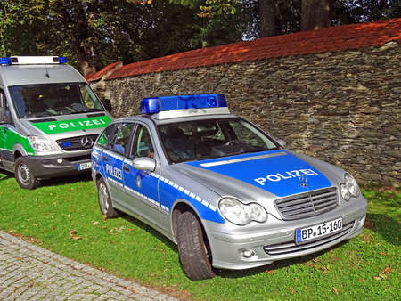 federal police: Chemnitz, Germany - September 13, 2015: Two German police cars of the brand Mercedes-Benz parked on a lawn. They were presented during a public festival of the German Authorities in Chemnitz, Germany.