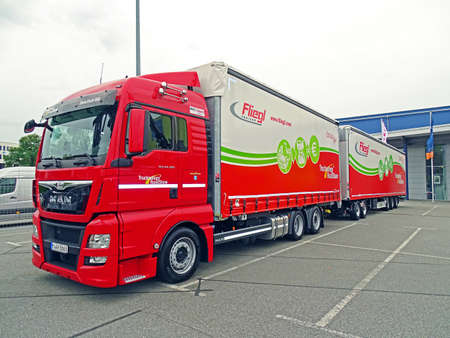 supposedly: Chemnitz, Germany - October 4, 2015: A truck with MAN to overlong Fliegl EUR Combi Roadtrain semitrailer parked in a parking lot in Chemnitz. Supposedly the transport of goods with longer vehicles Reduces the volume of traffic, relieves roads and pollutan