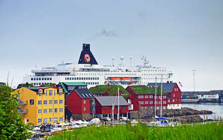 hirtshals: Torshavn, Faroe Islands - June 5, 2014: The ferry ship Norr�na from Smyril Line has moored in Torshavn. The ship arrived in the morning from Iceland and Which prepared for the onward journey to Hirtshals (Denmark). The Norr�na ferry is an important year-r