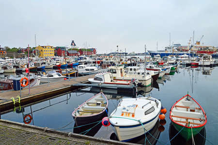oft: Torshavn, Faroe Islands - June 05, 2014: trawlers and pleasure boats in the port of Torshavn in the Faroe Islands. Fishing is an important source of income for the small country. The quietly practiced whaling but is oft Criticized from abroad.