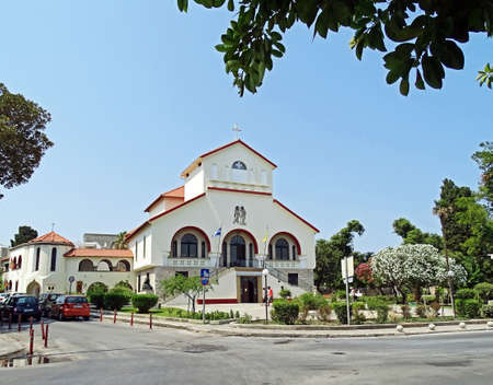kos: Kos, Greece - July 31, 2015: Evangelismos Church in Kos, the capital of the Iceland of Kos, Greece. The church which built in 1930 as a Catholic Church. It is the bishops residence and houses a library and a collection of old Byzantine icons.