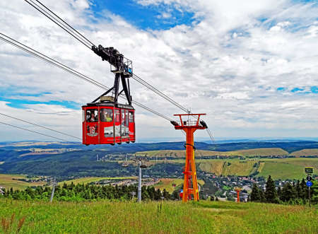 m: Oberwiesenthal, Germany - July 11, 2015: The Fichtelberg Cable Car (in German: fichtelberg cable car) is the oldest cable car in Germany. It connects the town Oberwiesenthal with the 1215 m high mountain Fichtelberg over a length of 1175 m. Between valley