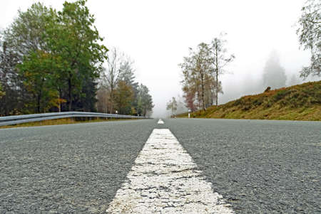 Misty mountain road in the Sauerland, Germany Stock Photo