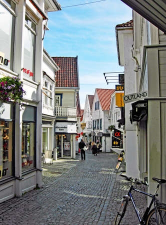 Stavanger, Norway - June 5, 2009: People walk on a small shopping street in the old town of Stavanger in Norway