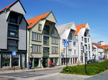 Stavanger, Norway - June 5, 2009: Beautifully restored historic warehouses along the street Ostervagkaien at the port of Stavanger, Hordaland County, Norway. Editorial