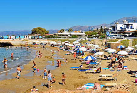 Hersonissos, Greece - July 14, 2016: Many people enjoy a summer day at the Star Beach of Hersonissos on the Iceland of Crete in Greece.