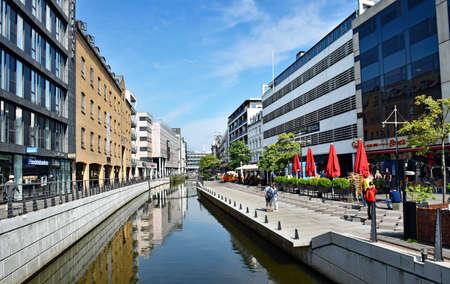 Aarhus, Denmark - July 20, 2017: Promenade along the river Aarhus in the city center of the town of Aarhus in Denmark.