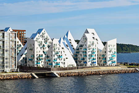 Aarhus, Denmark - July 20, 2017: View from the sea to the residential complex Isbjerget (iceberg) in Aarhus, Denmark. It is located in the center of the city.