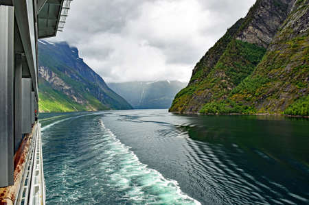 Cruise on a ship through the Geirangerfjord in Norway