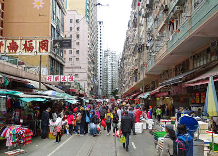 North Point, Hong Kong - February 10, 2016: Many people stroll along the many shops on Chun Yeung Street in the North Point district of Hong Kong. Editorial