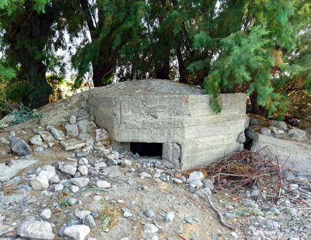 Destroyed bunker on the beach of Psalidi on the Mediterranean island of Kos in Greece