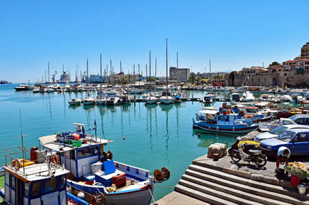 Heraklion, Greece - July 15, 2016: Small fishing boats and yachts are moored at the Old Venetian Harbor of Heraklion on the island of Crete, Greece. Editorial