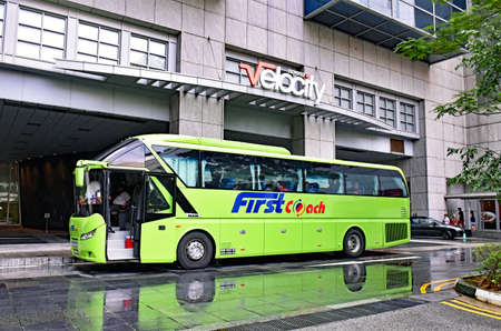 Novena, Singapore - February 21, 2017: A FirstCoach long distance bus is ready at the Velocity Novena Square shopping center to depart for Bandar Utama  Kuala Lumpur in Malaysia.