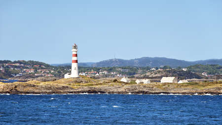 Lighthouse Oks�y fyr south of Kristiansand in Norway. Stock Photo