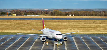 Dresden, Germany - February 12, 2018: An Airbus A319-100 from Germanwings, a Lufthansa subsidiary, is pushing into take-off position at a Dresden International Airport. 新聞圖片