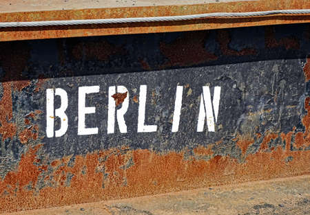 Lettering BERLIN on rusty side wall of a freight forwarder Stock Photo