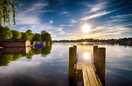 Sunset on the lake with jetty in Malchow (Mecklenburg-Vorpommern  Germany)