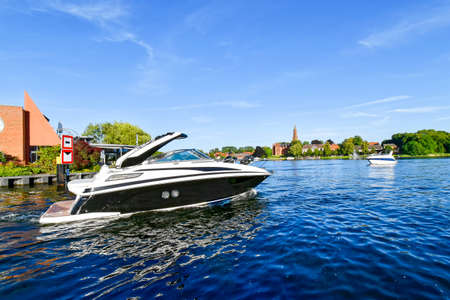 Modern motor yacht on the lake at Malchow in Mecklenburg-Vorpommern (Germany) Stock Photo - 107327201