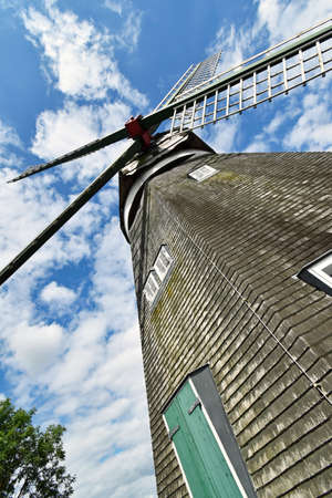 View of a windmill from the bottom up to the wings Stock Photo