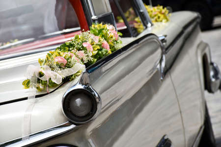 Old American limousine decorated as a wedding car