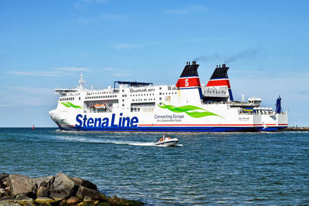 Warnemunde, Germany - July 14, 2017: Stena Line leaves the port of Rostock (Germany) towards Trelleborg in Sweden. The Skane is the largest combined railway and ro-pax ferry in the world.
