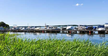 Ships moored at Fleesen Lake jetty in Göhren-Lebbin (Germany) Stock Photo